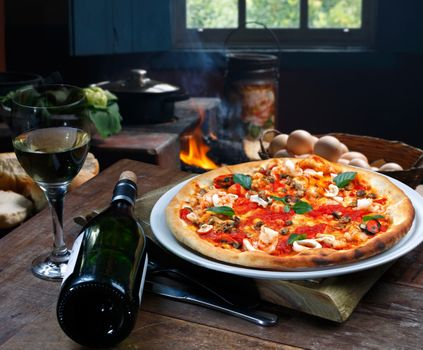 Pizza and bottle of wine · free photo