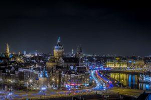 Фото бесплатно Вид на Принц Хендриккаде и церковь Святого Николая, Амстердам, Нидерланды