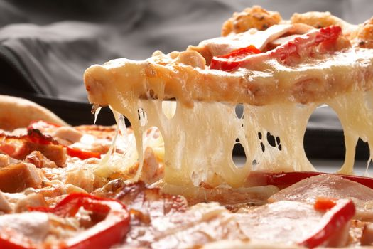 Stunning piece of cheese pizza · free photo