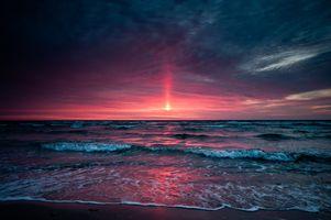 Розовый вечер на морском берегу · бесплатное фото