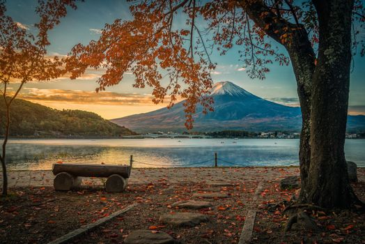Bench by the river with views of the slopes of Mount Fuji · free photo