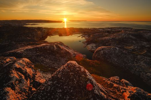 Закат на берегу Баренцева моря · бесплатное фото