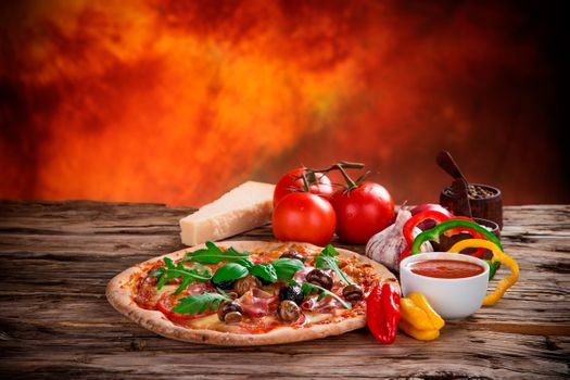 Pizza on a fiery background · free photo