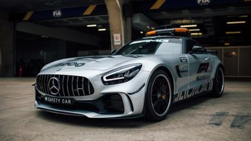 Mercedes AMG GT C with flashing lights leaves the tunnel
