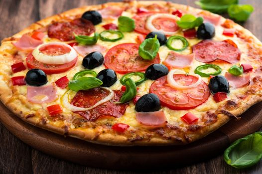 Kick-ass pizza with olives · free photo
