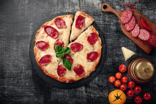Pizza with sausage · free photo