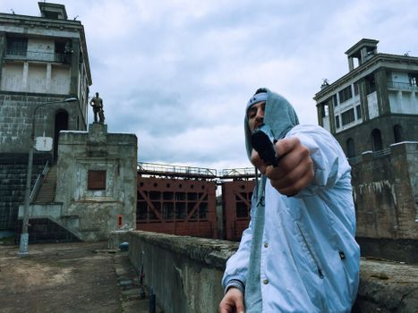 The rapper with a gun wants to shoot