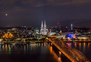 Бесплатные фото Кёльнский собор,Кёльн,Германия,Мост Гогенцоллернов,река Рейн,ночь,иллюминация