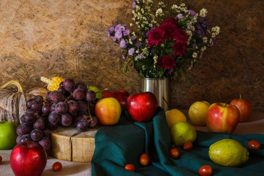 Still life with fruit and a bouquet · free photo