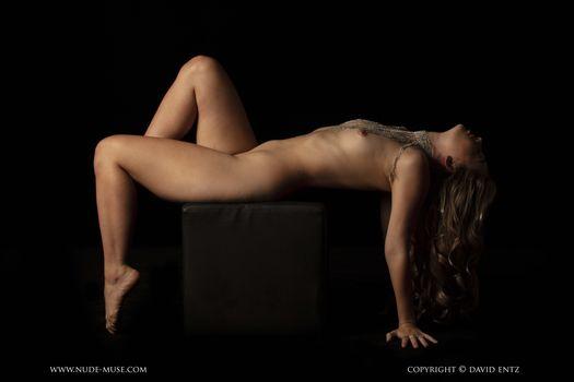 Photo free naked, on a stool, black background
