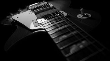 Гитара  и струны крупным планом · бесплатное фото