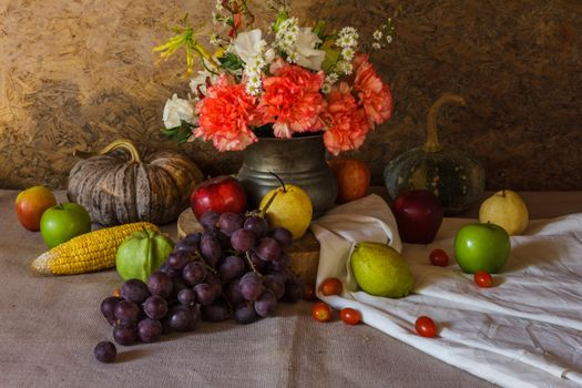 Still life with grapes and a carnation · free photo