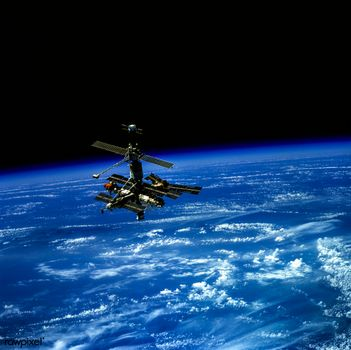 Photo free The Russian space station Mir, located on the horizon of the Earth Original NASA Digitally enhanced rawpixel, space