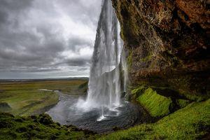 Бесплатные фото Водопад Сельяландсфосс,Исландия,скалы,поле,небо,поток,пейзаж