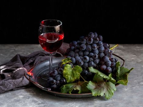 Glass of wine and a bunch of grapes