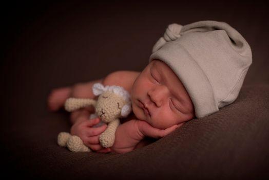 Бесплатные фото сон,игрушка,ребенок,малыш,младенец,шапочка,овечка,sleep,toy,child,baby,cap