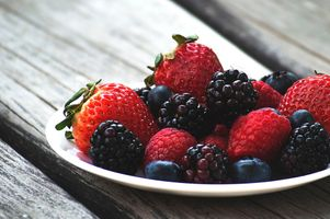 Various berries on the plate · free photo