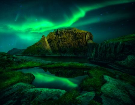 Rocks and northern lights · free photo
