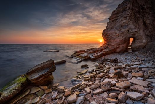 The cave in the rock by the sea · free photo