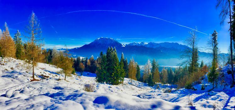 Фото бесплатно Зимняя панорама Альп с горами Кайзер над долиной реки Инн близ Киферсфельдена, Бавария, Германия